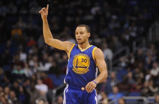 Nov 26, 2014; Orlando, FL, USA; Golden State Warriors guard Stephen Curry (30) celebrates a three-point basket against the Orlando Magic in the first quarter at Amway Center. Mandatory Credit: David Manning-USA TODAY Sports