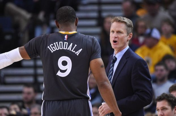 December 27, 2014; Oakland, CA, USA; Golden State Warriors head coach Steve Kerr (right) instructs guard Andre Iguodala (9) against the Minnesota Timberwolves during the third quarter at Oracle Arena. The Warriors defeated the Timberwolves 110-97. Mandatory Credit: Kyle Terada-USA TODAY Sports