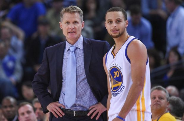 December 2, 2014; Oakland, CA, USA; Golden State Warriors head coach Steve Kerr (left) talks to guard Stephen Curry (30) during the fourth quarter against the Orlando Magic at Oracle Arena. The Warriors defeated the Magic 98-97. Mandatory Credit: Kyle Terada-USA TODAY Sports