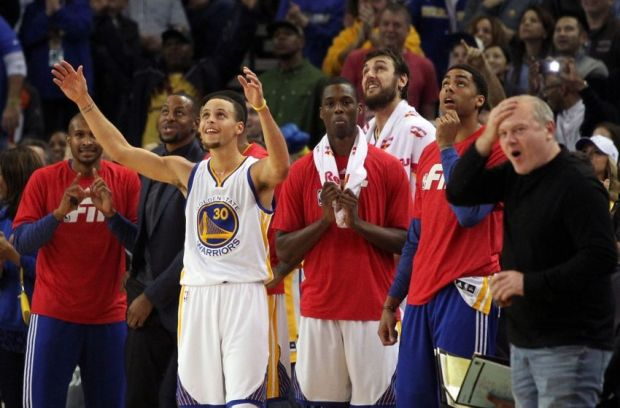 Jan 23, 2015; Oakland, CA, USA; Golden State Warriors guard Stephen Curry (30) celebrates Klay Thompson (11) (not pictured) 50th point against the Sacramento Kings in the second half of their NBA basketball game at Oracle Arena. Mandatory Credit: Lance Iversen-USA TODAY Sports. Thompson set a record 52 points in their win over the kings.