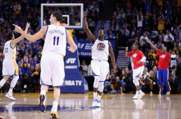Jan 21, 2015; Oakland, CA, USA; Golden State Warriors center Andrew Bogut (12), guard Klay Thompson (11), and forward Draymond Green (23) celebrate after the Warriors' score against the Houston Rockets during the third quarter at Oracle Arena. The Warriors won 126-113. Mandatory Credit: Kelley L Cox-USA TODAY Sports