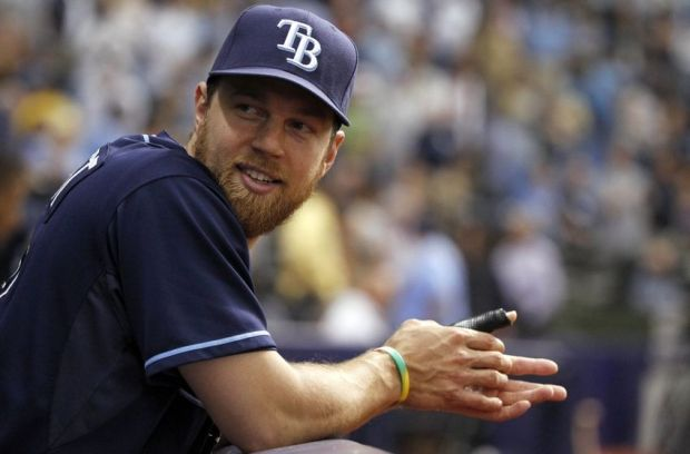 May 22, 2014; St. Petersburg, FL, USA; Tampa Bay Rays second baseman Ben Zobrist (18) holds his dislocated thumb that is in a cast  while in the dugout against the Oakland Athletics Tropicana Field. Mandatory Credit: Kim Klement-USA TODAY Sports