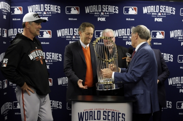 Oct 29, 2014; Kansas City, MO, USA; MLB commissioner Bud Selig (right) presents San Francisco Giants manager Bruce Bochy (left) , chief executive officer Larry Baer (middle) and general manager Brian Sabean with the Commissioners Trophy after game seven of the 2014 World Series against the Kansas City Royals at Kauffman Stadium. Mandatory Credit: Charlie Neibergall/Pool Photo via USA TODAY Sports