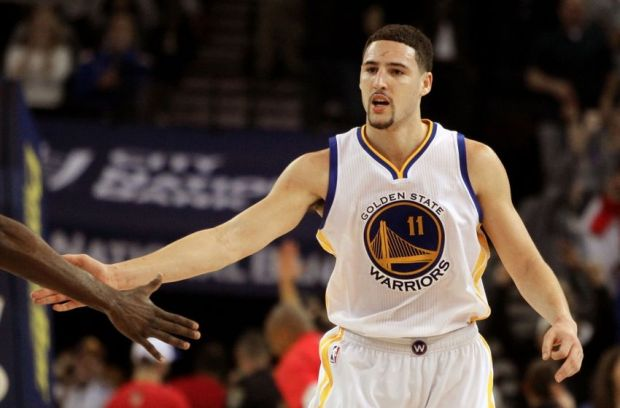 Jan 23, 2015; Oakland, CA, USA; Golden State Warriors guard Klay Thompson (11) is greeted after scoring a three point shot against the Sacramento Kings in the second half of their NBA basketball game at Oracle Arena. Mandatory Credit: Lance Iversen-USA TODAY Sports. Thompson set a record 52 points in their win over the kings.