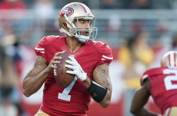 Dec 28, 2014; Santa Clara, CA, USA; San Francisco 49ers quarterback Colin Kaepernick (7) drops back for a pass against the Arizona Cardinals during the third quarter at Levi's Stadium. The against the San Francisco 49ers defeated the Arizona Cardinals 20-17. Mandatory Credit: Ed Szczepanski-USA TODAY Sports
