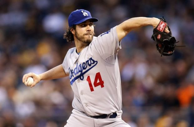 Jul 23, 2014; Pittsburgh, PA, USA; Los Angeles Dodgers starting pitcher Dan Haren (14) delivers a pitch against the Pittsburgh Pirates during the second inning at PNC Park. Mandatory Credit: Charles LeClaire-USA TODAY Sports