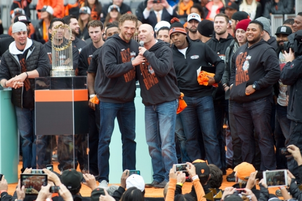 Oct 31, 2014; San Francisco, CA, USA; San Francisco Giants starting pitcher Tim Hudson and right fielder Hunter Pence speak to the crowd during the World Series celebration at City Hall. The San Francisco Giants defeated the Kansas City Royals in game seven of the World Series. Mandatory Credit: Ed Szczepanski-USA TODAY Sports
