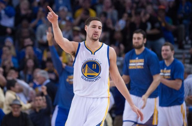 January 7, 2015; Oakland, CA, USA; Golden State Warriors guard Klay Thompson (11) celebrates after a basket during the third quarter against the Indiana Pacers at Oracle Arena. The Warriors defeated the Pacers 117-102. Mandatory Credit: Kyle Terada-USA TODAY Sports
