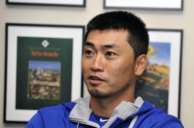 Oct 9, 2014; Baltimore, MD, USA; Kansas City Royals right fielder Nori Aoki (23) is interviewed before workouts the day before game one of the 2014 ALCS at Oriole Park at Camden Yards. Mandatory Credit: Joy R. Absalon-USA TODAY Sports