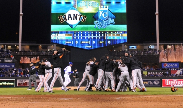 Oct 29, 2014; Kansas City, MO, USA; San Francisco Giants players celebrate on the field after defeating the Kansas City Royals during game seven of the 2014 World Series at Kauffman Stadium. Mandatory Credit: Peter G. Aiken-USA TODAY Sports