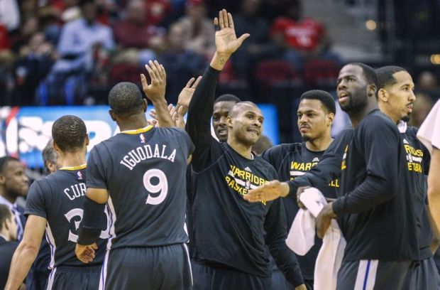 Jan 17, 2015; Houston, TX, USA; Members of the Golden State Warriors celebrate after a play during the second half against the Houston Rockets at Toyota Center. The Warriors defeated the Rockets 131-106. Mandatory Credit: Troy Taormina-USA TODAY Sports
