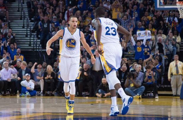 January 7, 2015; Oakland, CA, USA; Golden State Warriors guard Stephen Curry (30) celebrates with forward Draymond Green (23) against the Indiana Pacers during the second quarter at Oracle Arena. Mandatory Credit: Kyle Terada-USA TODAY Sports