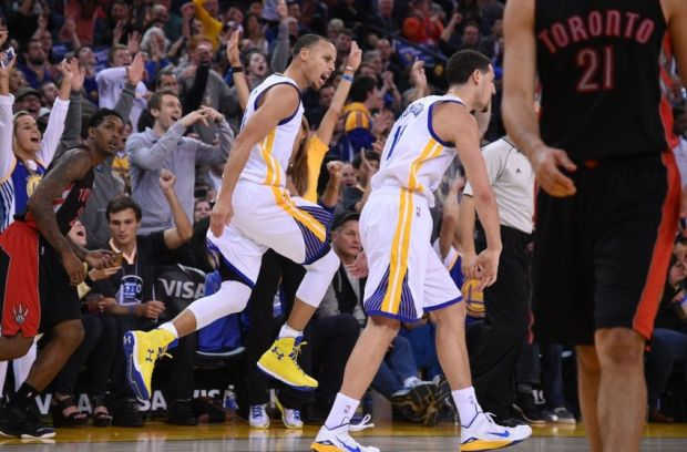 January 2, 2015; Oakland, CA, USA; Golden State Warriors guard Stephen Curry (30) congratulates guard Klay Thompson (11) for making a three-point basket during the third quarter against the Toronto Raptors at Oracle Arena. The Warriors defeated the Raptors 126-105. Mandatory Credit: Kyle Terada-USA TODAY Sports