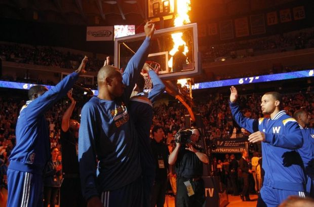 Jan 9, 2015; Oakland, CA, USA; Golden State Warriors guard Stephen Curry (30) is introduced before the start of the game against the Cleveland Cavaliers at Oracle Arena. The Warriors defeated the Cavaliers 112-94. Mandatory Credit: Cary Edmondson-USA TODAY Sports