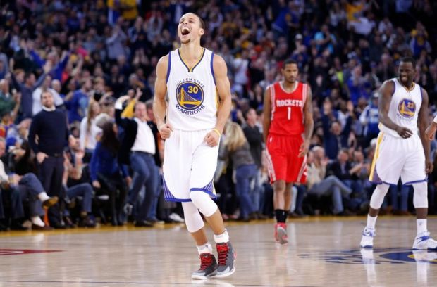Jan 21, 2015; Oakland, CA, USA; Golden State Warriors guard Stephen Curry (30) reacts after a basket against the Houston Rockets during the second quarter at Oracle Arena. Mandatory Credit: Kelley L Cox-USA TODAY Sports