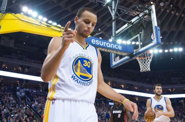 January 14, 2015; Oakland, CA, USA; Golden State Warriors guard Stephen Curry (30) celebrates after a basket against the Miami Heat during the third quarter at Oracle Arena. The Warriors defeated the Heat 104-89. Mandatory Credit: Kyle Terada-USA TODAY Sports