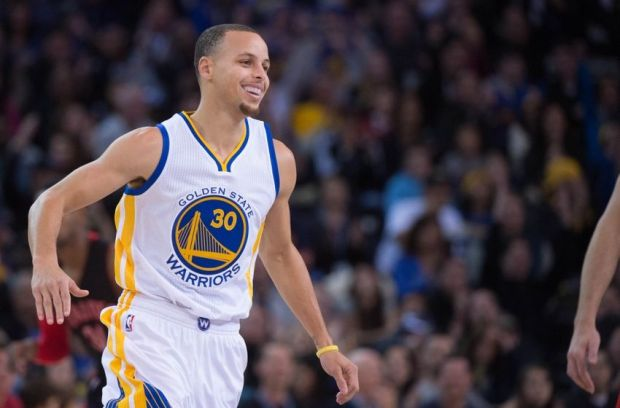 January 2, 2015; Oakland, CA, USA; Golden State Warriors guard Stephen Curry (30) celebrates during the first quarter against the Toronto Raptors at Oracle Arena. The Warriors defeated the Raptors 126-105. Mandatory Credit: Kyle Terada-USA TODAY Sports