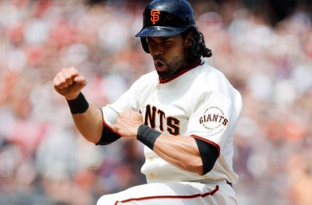 Aug 13, 2014; San Francisco, CA, USA; San Francisco Giants center fielder Angel Pagan (16) reacts after scoring a run against the Chicago White Sox during the seventh inning at AT&T Park. Mandatory Credit: Kelley L Cox-USA TODAY Sports