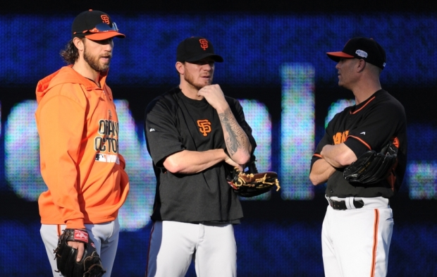 Oct 20, 2014; Kansas City, MO, USA; San Francisco Giants starting pitchers Madison Bumgarner (left), Jake Peavy (22) and Tim Hudson (17) during practice the day before the start of the 2014 World Series at Kauffman Stadium. Mandatory Credit: Christopher Hanewinckel-USA TODAY Sports