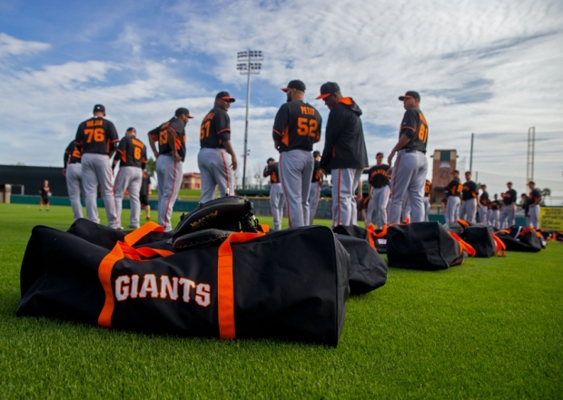 Feb 19, 2015; Glendale, AZ, USA; San Francisco Giants players prepare to stretch on the field as their bags sit in the grass during spring training practice at Scottsdale Stadium. Mandatory Credit: Mark J. Rebilas-USA TODAY Sports