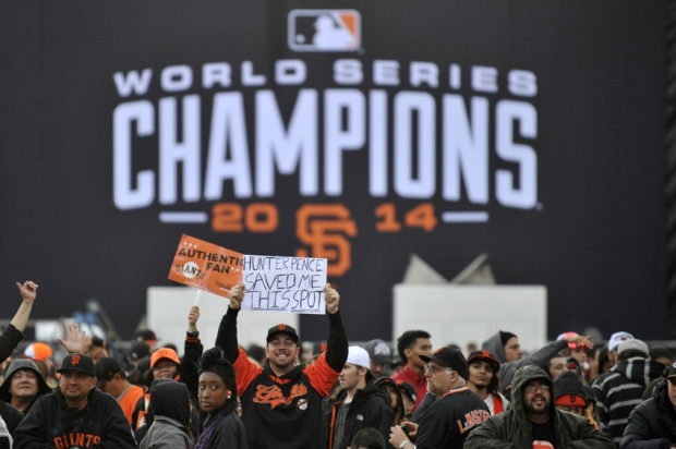 Oct 31, 2014; San Francisco, CA, USA; A San Francisco Giants fan holds up a sign before the World Series victory parade at City Hall. The San Francisco Giants defeated the Kansas City Royals in game seven of the World Series. Mandatory Credit: Ed Szczepanski-USA TODAY Sports
