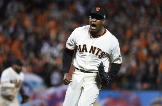 Oct 15, 2014; San Francisco, CA, USA; San Francisco Giants relief pitcher Santiago Casilla (46) celebrates after beating the St. Louis Cardinals in game four of the 2014 NLCS playoff baseball game at AT&T Park. Mandatory Credit: Kyle Terada-USA TODAY Sports