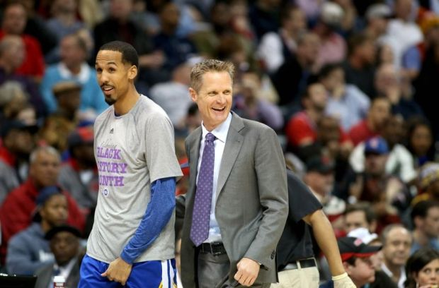 Feb 6, 2015; Atlanta, GA, USA; Golden State Warriors head coach Steve Kerr reacts on the bench with guard Shaun Livingston (34) in the first quarter of their game against the Atlanta Hawks at Philips Arena. Mandatory Credit: Jason Getz-USA TODAY Sports