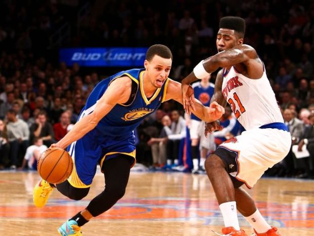 Feb. 27, 2013; New York, NY, USA; Golden State Warriors point guard Stephen Curry (30) drives to the net around New York Knicks point guard Iman Shumpert (21) during the second quarter at Madison Square Garden. Mandatory Credit: Debby Wong-USA TODAY Sports