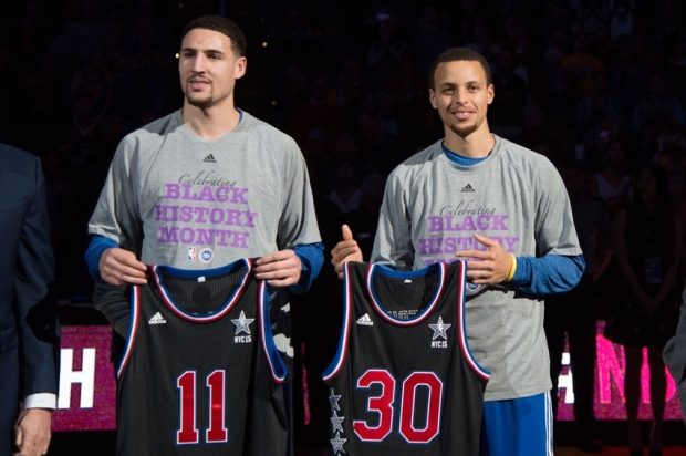 February 4, 2015; Oakland, CA, USA; Golden State Warriors guard Klay Thompson (11) and guard Stephen Curry (30) pose with the All-Star jerseys before the game against the Dallas Mavericks at Oracle Arena. Mandatory Credit: Kyle Terada-USA TODAY Sports