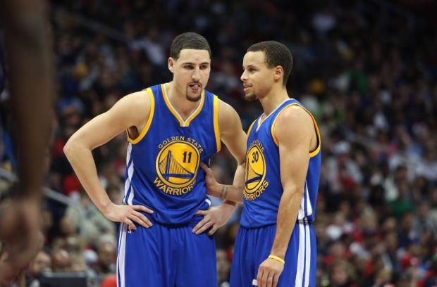 Feb 6, 2015; Atlanta, GA, USA; Golden State Warriors guard Klay Thompson (11) and guard Stephen Curry (30) talk in the third quarter of their game against the Atlanta Hawks at Philips Arena. The Hawks won 124-116. Mandatory Credit: Jason Getz-USA TODAY Sports