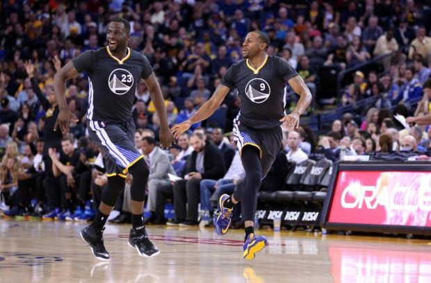 Mar 21, 2015; Oakland, CA, USA; Golden State Warriors forward Draymond Green (23) and guard Andre Iguodala (9) celebrate after Iguodala's basket against the Utah Jazz during the fourth quarter at Oracle Arena. The Golden State Warriors defeated the Utah Jazz 106-91. Mandatory Credit: Kelley L Cox-USA TODAY Sports