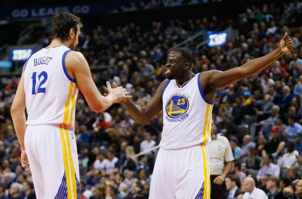 Feb 27, 2015; Toronto, Ontario, CAN; Golden State Warriors forward Draymond Green (23) and center Andrew Bogut (12) celebrate against the Toronto Raptors at the Air Canada Centre. Golden State defeated Toronto 113-89. Mandatory Credit: John E. Sokolowski-USA TODAY Sports