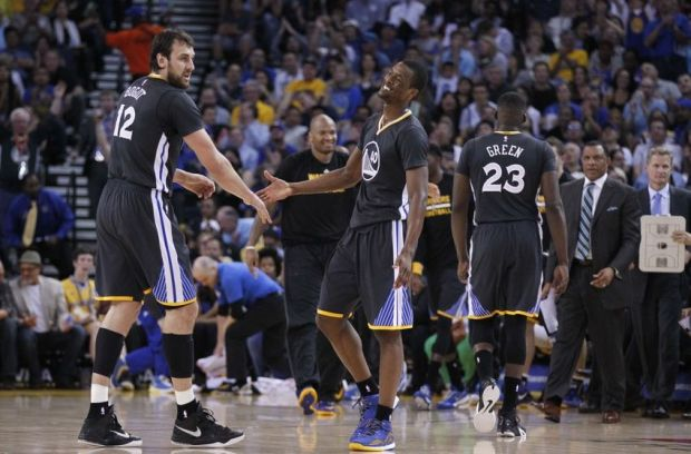 Mar 14, 2015; Oakland, CA, USA; Golden State Warriors forward Harrison Barnes (40) is congratulated by center Andrew Bogut (12) after making a shot against the New York Knicks in the third quarter at Oracle Arena. The Warriors defeated the Knicks 125-94. Mandatory Credit: Cary Edmondson-USA TODAY Sports