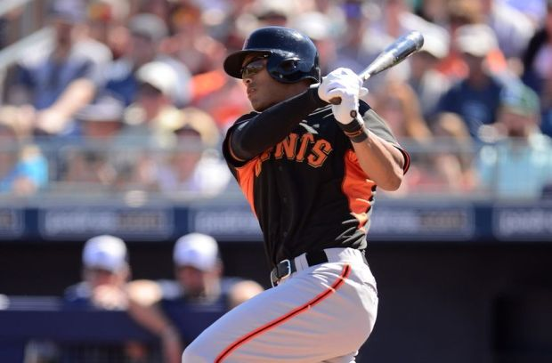Mar 10, 2015; Peoria, AZ, USA; San Francisco Giants center fielder Justin Maxwell (43) swings the bat against the San Diego Padres at Peoria Sports Complex. Mandatory Credit: Joe Camporeale-USA TODAY Sports