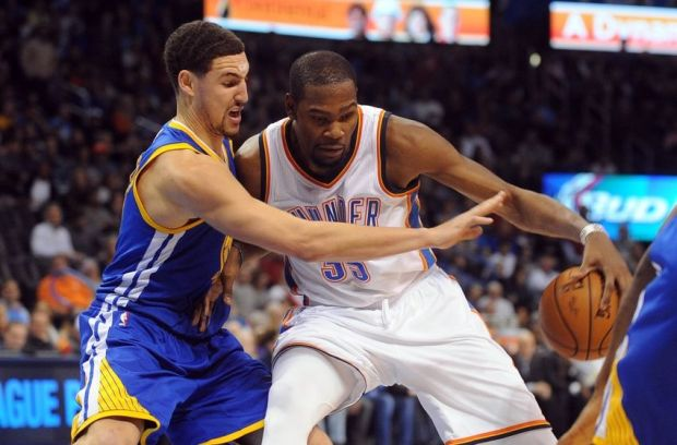 Jan 16, 2015; Oklahoma City, OK, USA;  Oklahoma City Thunder forward Kevin Durant (35) handles the ball against Golden State Warriors guard Klay Thompson (11) during the fourth quarter at Chesapeake Energy Arena. Mandatory Credit: Mark D. Smith-USA TODAY Sports
