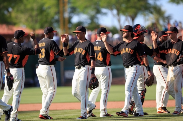 Mar 29, 2015; Scottsdale, AZ, USA; San Francisco Giants players celebrate after their 11-9 win over the Los Angeles Dodgers during a spring training game at Scottsdale Stadium. Mandatory Credit: Allan Henry-USA TODAY Sports