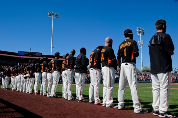 Mar 4, 2015; Scottsdale, AZ, USA; The San Francisco Giants look on during the National Anthem before a spring training baseball game against the Oakland Athletics at Scottsdale Stadium. Mandatory Credit: Matt Kartozian-USA TODAY Sports