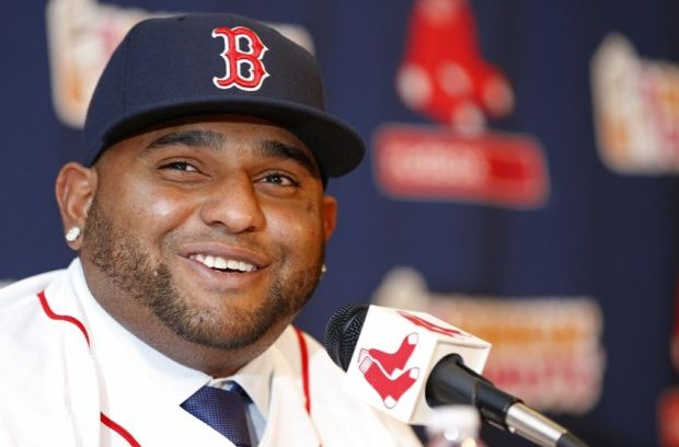 Nov 25, 2014; Boston, Ma, USA; Boston Red Sox third baseman Pablo Sandoval talks with the media during his introductory press conference at Fenway Park. Mandatory Credit: Greg M. Cooper-USA TODAY Sports