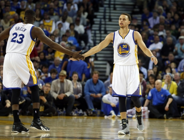 Mar 20, 2015; Oakland, CA, USA; Golden State Warriors forward Draymond Green (23) congratulates guard Stephen Curry (30) after Curry scored during the third quarter at Oracle Arena. Mandatory Credit: Bob Stanton-USA TODAY Sports
