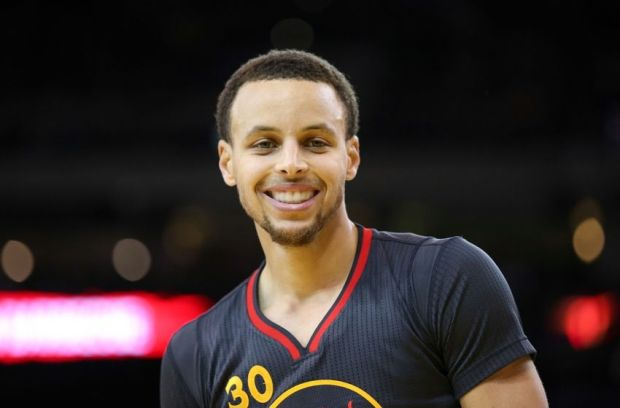 Mar 4, 2015; Oakland, CA, USA; Golden State Warriors guard Stephen Curry (30) smiles between plays against the Milwaukee Bucks during the second quarter at Oracle Arena. Mandatory Credit: Kelley L Cox-USA TODAY Sports