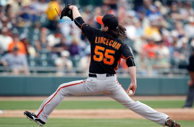 Mar 3, 2015; Mesa, AZ, USA; San Francisco Giants starting pitcher Tim Lincecum (55) throws in the third inning against the Oakland Athletics at HoHoKam Stadium. Mandatory Credit: Rick Scuteri-USA TODAY Sports
