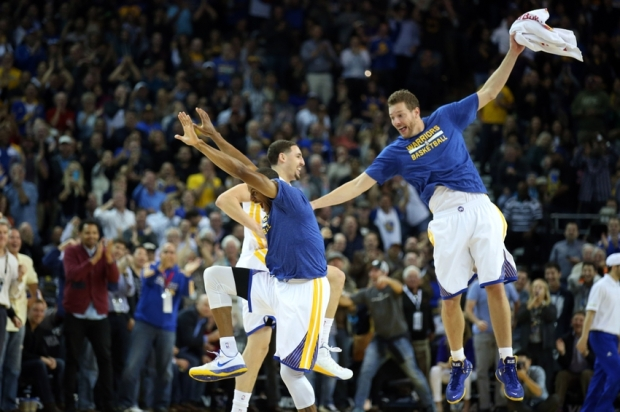 Apr 13, 2015; Oakland, CA, USA; Golden State Warriors guard Klay Thompson (11) celebrates with guard Andre Iguodala (9) and forward David Lee (10) as a timeout is called after Thompson scored a three point basket against the Memphis Grizzlies during the second quarter at Oracle Arena. Mandatory Credit: Kelley L Cox-USA TODAY Sports