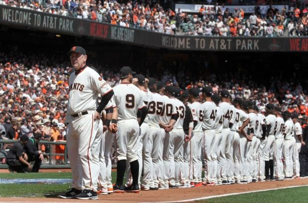 Apr 13, 2015; San Francisco, CA, USA; San Francisco Giants manager Bruce Bochy leads this players onto the field during opening day festivities at AT&T Park in San Francisco. Mandatory Credit: Lance Iversen-USA TODAY Sports
