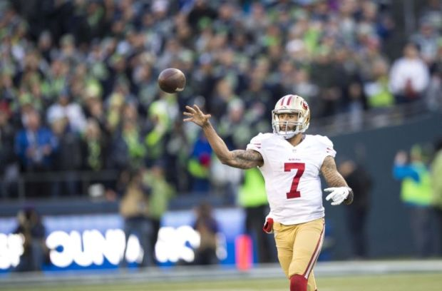 Dec 14, 2014; Seattle, WA, USA; San Francisco 49ers quarterback Colin Kaepernick (7) passes the ball against the Seattle Seahawks during the second half at CenturyLink Field. Seattle defeated San Francisco 17-7. Mandatory Credit: Steven Bisig-USA TODAY Sports