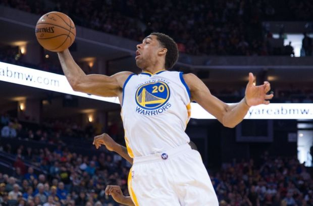 January 19, 2015; Oakland, CA, USA; Golden State Warriors forward James Michael McAdoo (20) grabs a rebound against the Denver Nuggets during the fourth quarter at Oracle Arena. The Warriors defeated the Nuggets 122-79. Mandatory Credit: Kyle Terada-USA TODAY Sports