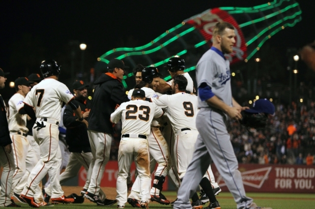 Apr 22, 2015; San Francisco, CA, USA; San Francisco Giants second baseman Joe Panik (12) is mobbed by his teammates after he hit the game winning hit in the ninth inning against the Los Angeles Dodgers at AT&T Park. Mandatory Credit: Lance Iversen-USA TODAY Sports, giants win 3-2.