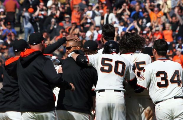 Apr 23, 2015; San Francisco, CA, USA; San Francisco Giants right fielder Justin Maxwell (no hat) is mobbed by his teammates after hitting a sacrifice fly ball scoring center fielder Angel Pagan (not pictured) in the tenth inning against the Los Angeles Dodgers at AT&T Park. Mandatory Credit: Lance Iversen-USA TODAY Sports. Giants win 3-2.