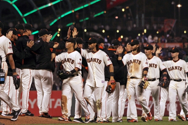 Apr 21, 2015; San Francisco, CA, USA; San Francisco Giants celebrate their 6-2 win over the Los Angeles Dodgers at AT&T Park. Mandatory Credit: Lance Iversen-USA TODAY Sports