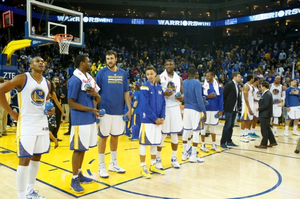 Apr 15, 2015; Oakland, CA, USA; Golden State Warriors line up before autographing jerseys for fans after the win against the Denver Nuggets at Oracle Arena. The Golden State Warriors defeated the Denver Nuggets 133-126. Mandatory Credit: Kelley L Cox-USA TODAY Sports