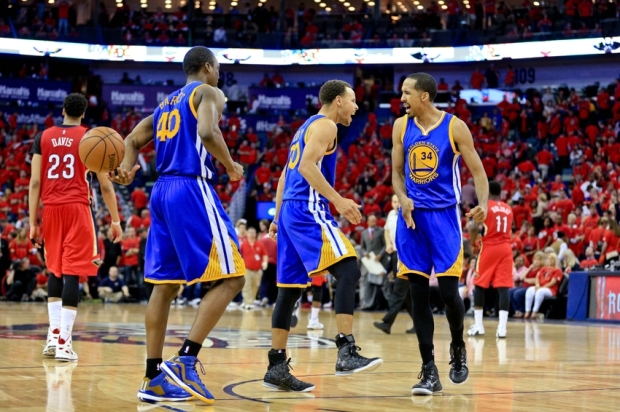 Apr 23, 2015; New Orleans, LA, USA; Golden State Warriors guard Stephen Curry (30) celebrates a win in overtime with teammates guard Shaun Livingston (34) and forward Harrison Barnes (40) as New Orleans Pelicans forward Anthony Davis (23) walks off the court at the end of game three of the first round of the NBA Playoffs at the Smoothie King Center. The Warriors defeated the Pelicans 123-119 in overtime. Mandatory Credit: Derick E. Hingle-USA TODAY Sports